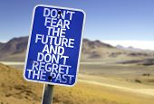 Don't Fear The Future and Don't Regret The Past sign with a desert background