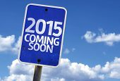 stock photo of say goodbye  - 2015 Coming Soon sign with sky background - JPG