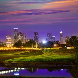 stock photo of nightfall  - Houston sunset skyline from Memorial park at Texas US - JPG