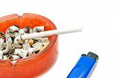 foto of cigarette lighter  - Blue Lighter and cigarette in ashtray on white closeup - JPG