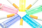 picture of cigarette lighter  - colorful lighters and few cigarettes on white closeup - JPG