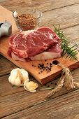 stock photo of ribs  - Raw prime rib beef steaks with spices - JPG