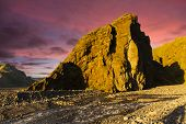 stock photo of midnight  - Midnight setting sun shines on beautiful volcanic rocks at Thorsmork - JPG