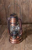 foto of kerosene lamp  - kerosene lamp is on a wooden background - JPG