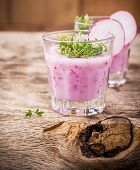 foto of radish  - detox smoothie with fresh radishes in two glasses on the wooden background with watercress and radish slices - JPG