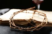 stock photo of crown-of-thorns  - Crown of thorns and old bible on black background - JPG