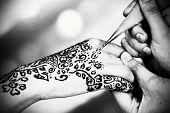 foto of mehndi  - Process of applying Mehndi on female hand - JPG