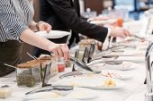 picture of buffet  - Tasty cheese and meat appetizers at the buffet table - JPG