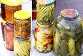 pic of pickled vegetables  - different vegetables pickles in glass jars containing paprika butter beans tomatoes cucumbers carrots cabbage