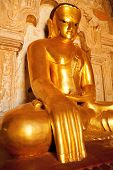 stock photo of mudra  - Close up of statue of Bhudda in earth - JPG