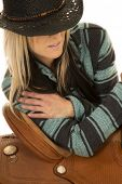 picture of cowgirls  - A cowgirl in her western hat leaning against her saddle - JPG