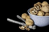 picture of nutcracker  - Nutcrackers and walnuts on a black background - JPG