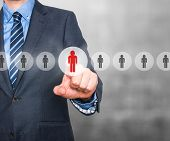 foto of recruiting  - Businessman pressing button on virtual screens - JPG
