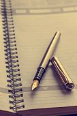 picture of scribes  - Open notebook with a fountain pen - JPG