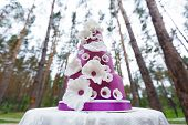 image of sugar paste  - Grand violet wedding cake with white sugar paste flowers - JPG