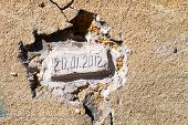 image of concrete  - Bricks laid in an old wall with the date of the bookmark - JPG