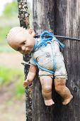 image of pedophilia  - Damaged Old Doll - JPG