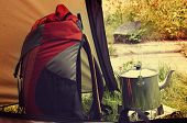 foto of tent  - Orange backback and kettle in the tent - JPG