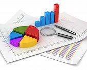 picture of graph paper  - Business chart and finance concept pie and bar chart and magnify glass and pen on financial paper - JPG