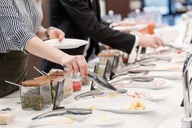 stock photo of tong  - Tasty cheese and meat appetizers at the buffet table - JPG