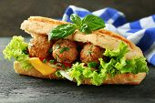 image of meatball  - Homemade Spicy Meatball Sub Sandwich on wooden table background - JPG