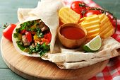 picture of potato chips  - Homemade tasty burrito with vegetables - JPG