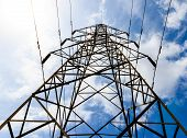 picture of power transmission lines  - High voltage transmission line tower against a cloudy sky - JPG