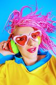 picture of dreadlock  - Ultra trendy DJ party girl in bright clothes - JPG