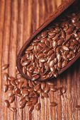foto of flax seed oil  - The flax seeds in a wooden bowl close up - JPG