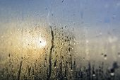stock photo of raindrops  - Mist and raindrops on glass pane after a night of rain - JPG