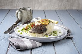 stock photo of halibut  - halibut roasted with herbs - JPG