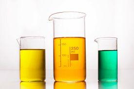 pic of beaker  - Measuring Beaker with color liquids on a white - JPG
