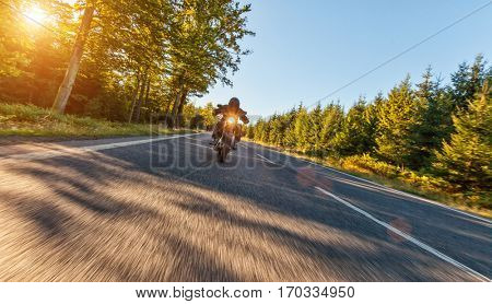 Motorcycle driver driving in beautiful