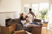 Parents Take A Break On Sofa With Son On Moving Day poster
