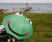 Smiling And Happy Green Umbrella