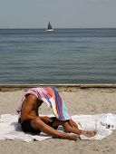 Young Man On The Beach Protecting Himself
