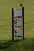 stock photo of crown green bowls  - A scoreboard - JPG