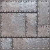 Old rustic metal plates with rivets seamless background or texture poster