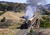 Restored steam locomotive travels through countryside