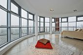 luxury modern penthouse apartment with floor to ceiling windows and panoramic views