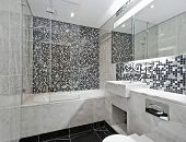 contemporary bathroom with marble hand wash basin and mosaic tiles