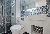 modern luxury bathroom with floor to ceiling mosaic tiles