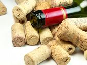 Bottle of vine with corks