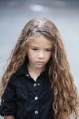 caucasian little girl portrait pout sad isolated studio on grey background
