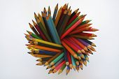 A pot of artist's coloring pencils, studio shot on a white background