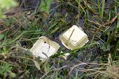 Polystyrene fast food packaging polluting a river bank
