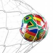 3d rendering of a soccer ball in a net with flags of the participating countries in world cup 2010