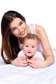 Happy young mother tenderly embracing her small baby. Family concept. Healthcare, pediatrics. Isolat poster