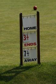 stock photo of crown green bowls  - A scoreboard - JPG