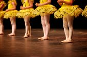 Dancers Performing On Stage In Yellow